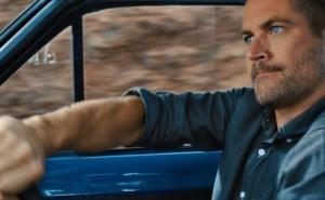 الممثل الراحل بوكل واكر يقود سيارة فورد اسكورت مكسيكو ام كي 1في فيلم فاست أند فيوريوس 6