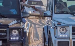 صورة تجمع حاكم دبي والشيخ فزاع مع سيارتيهما مرسيدس جي كلاس