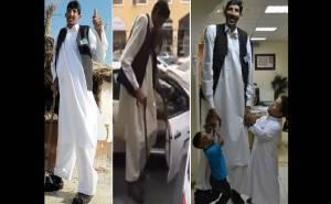 اطول رجل في العالم يستقل سيارة اجرة